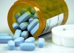 blue-pills-in-an-opened-bottle-2_-1fseough__S0000